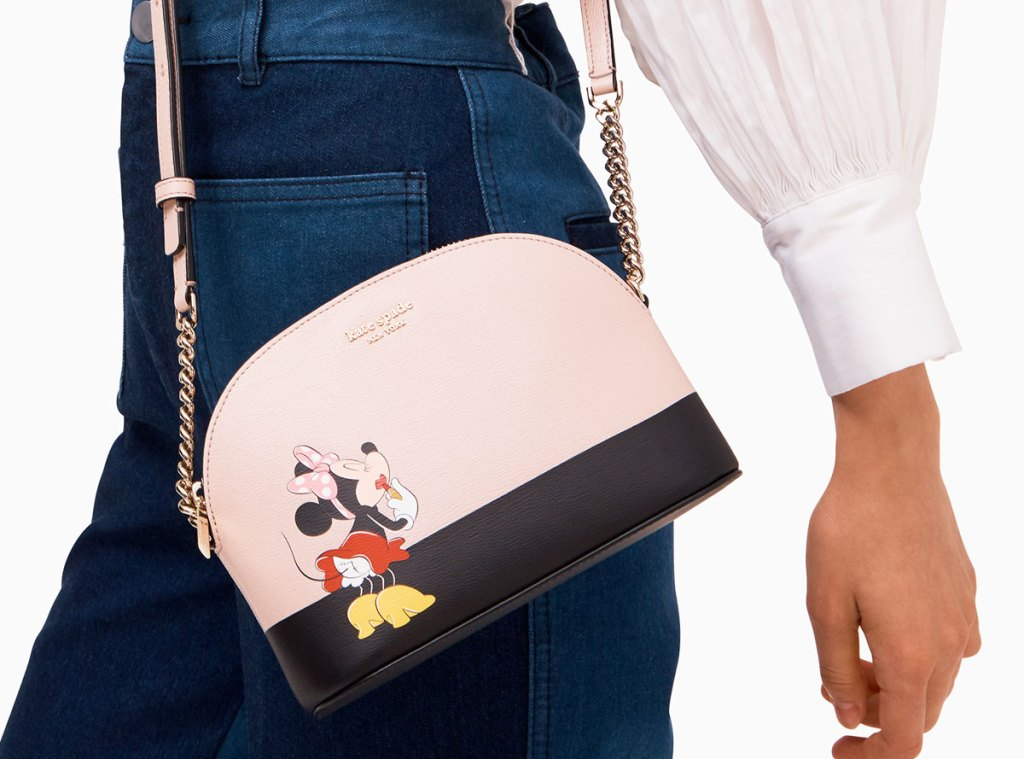 woman in high waisted jeans with a kate spade minniw mouse crossbody at her hip