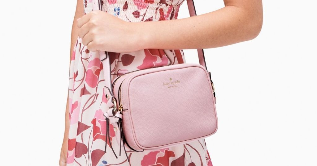 Lady wearing Pink Kate Spade Pyper crossbody
