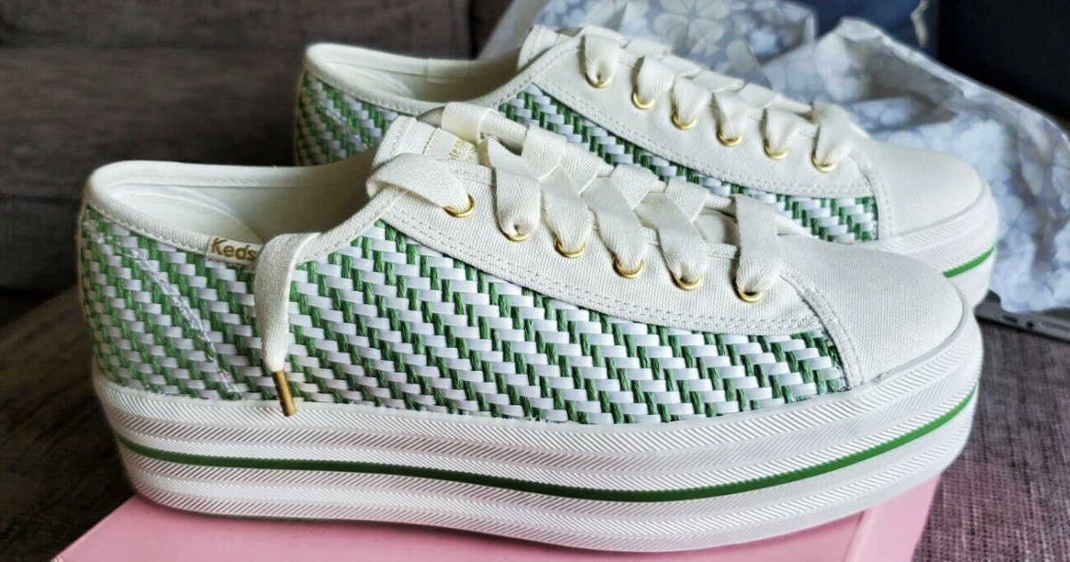 women's green and white woven stripe sneakers on pink shoe box