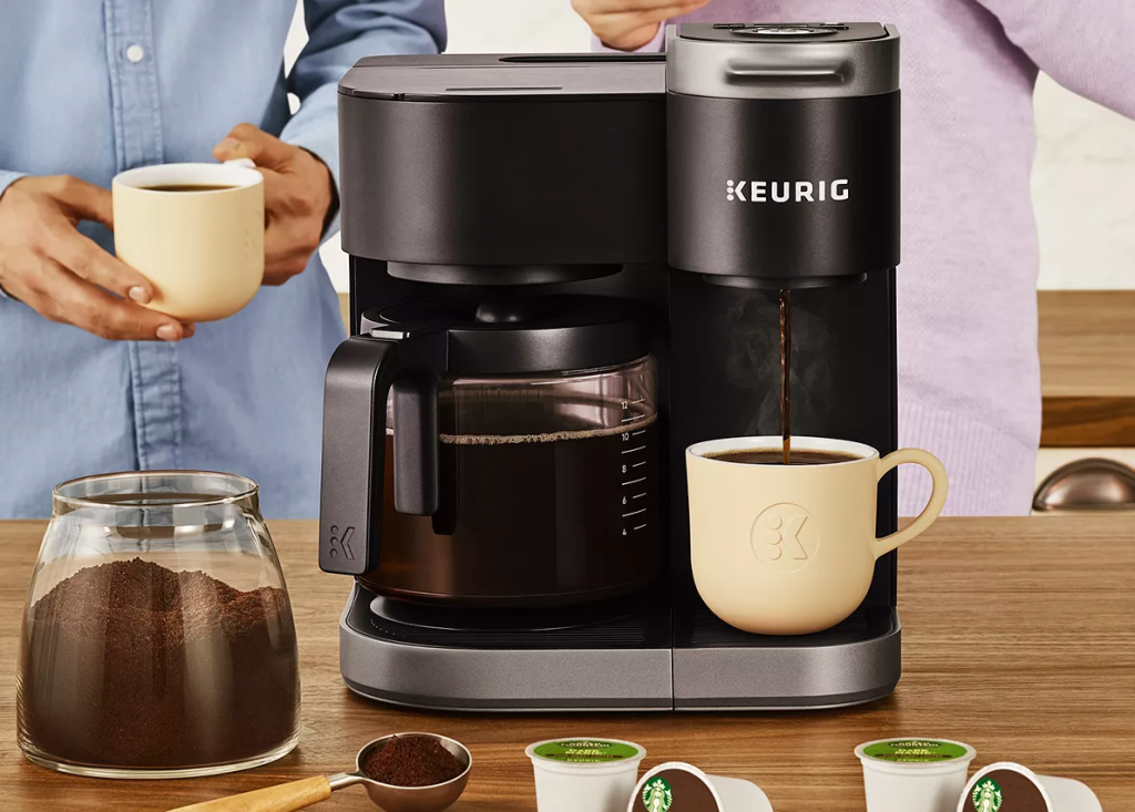 Keurig Coffee maker with a cup and a carafe on it