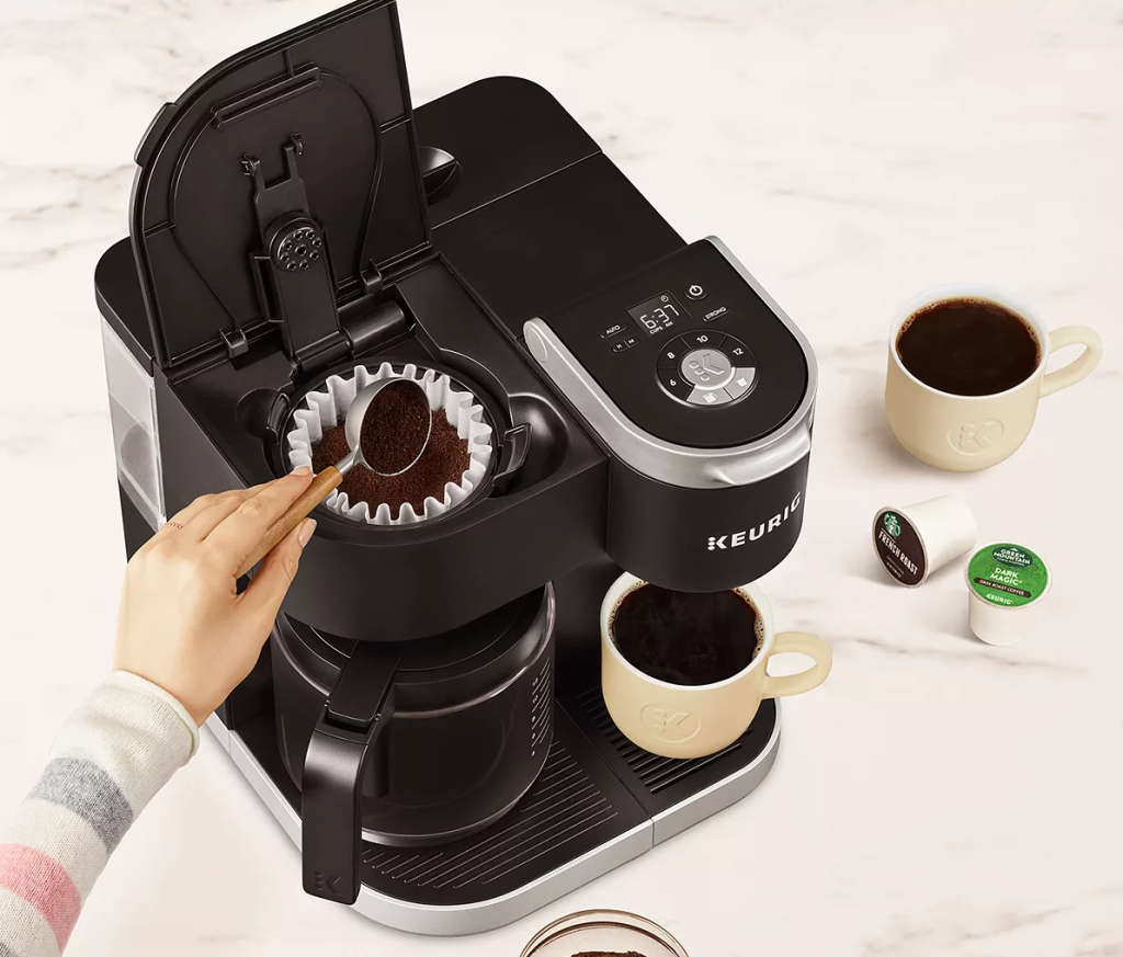 hand putting coffee in a coffee maker