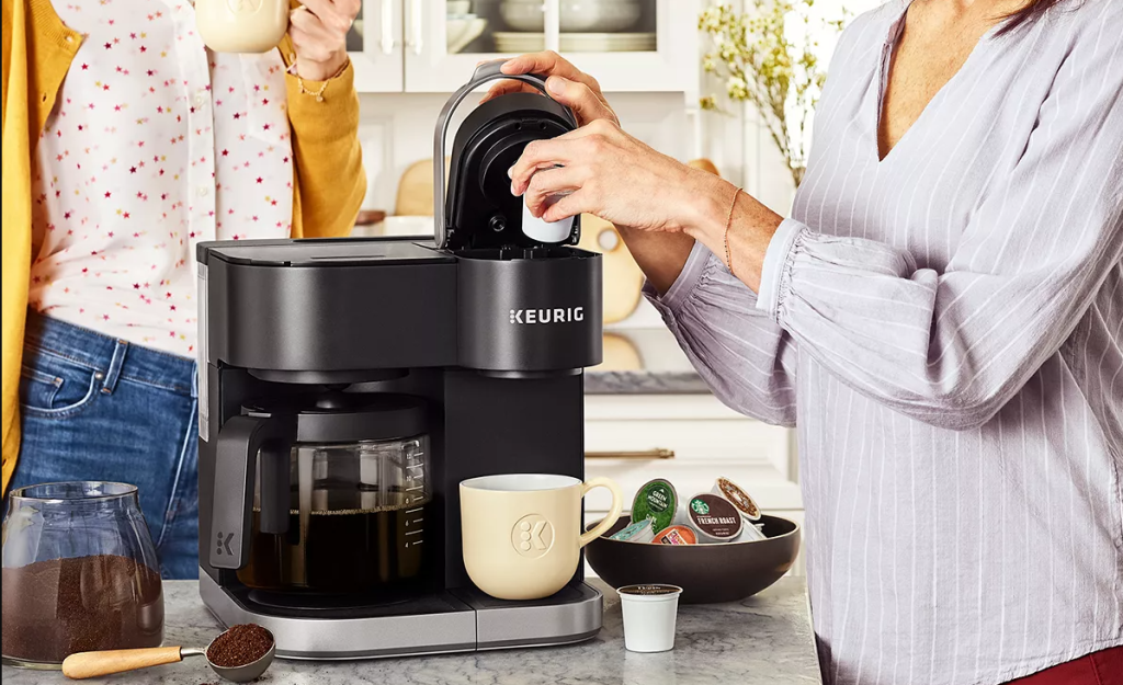 person putting a coffee pod in a coffee maker