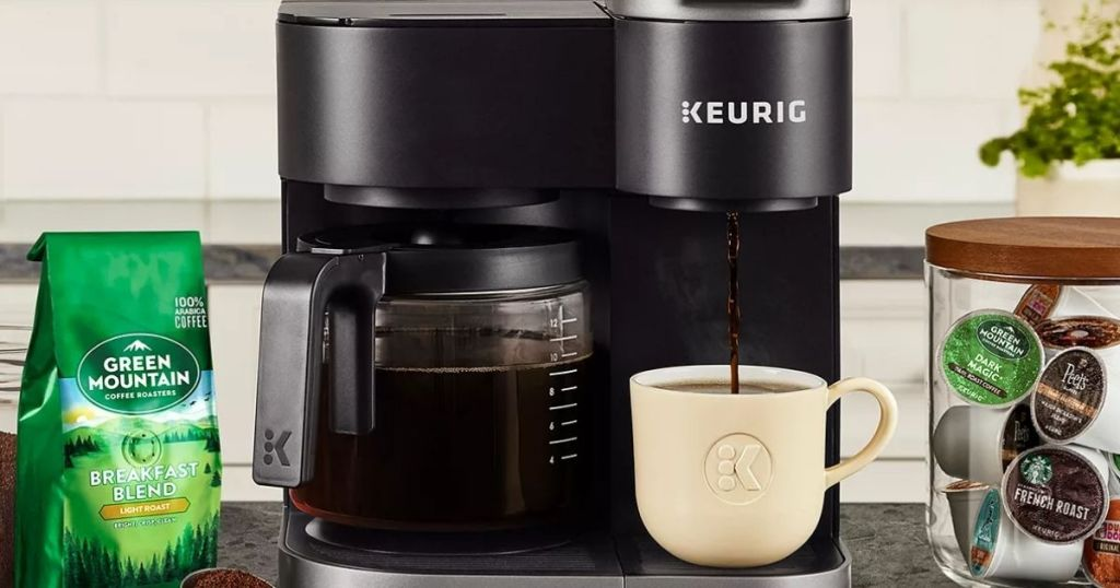 Keurig Duo coffee maker with coffee next to it