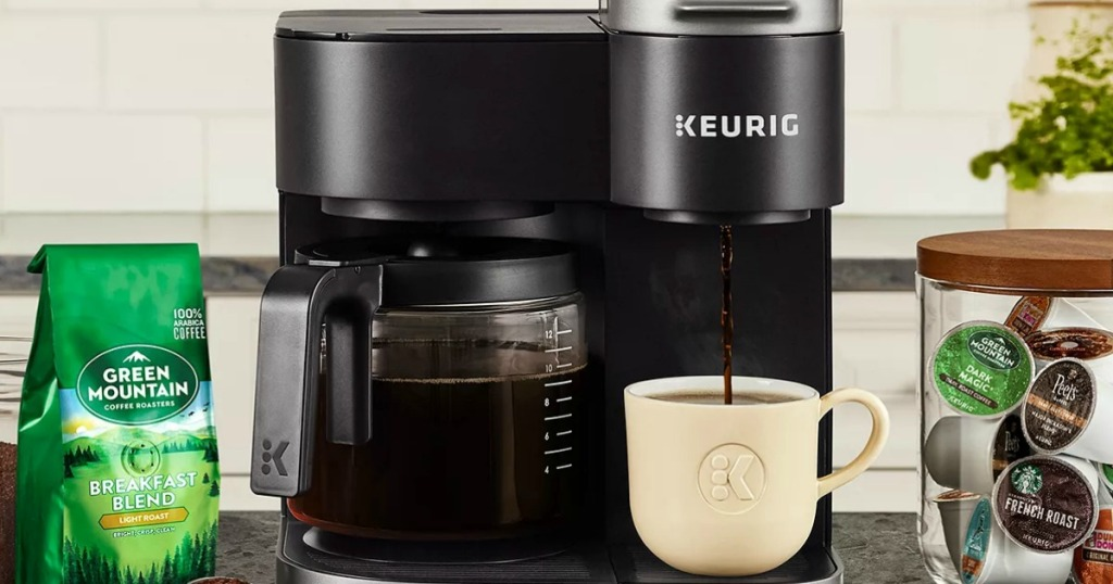 Large kcup coffee maker on counter top near kcup pods