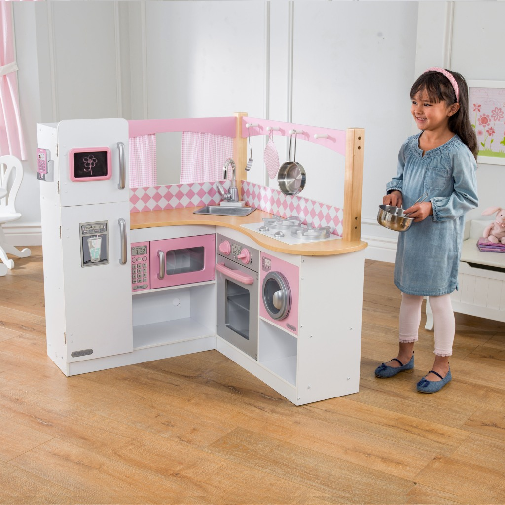 Little girl playing with Kidkraft Grand Gourmet kitchen