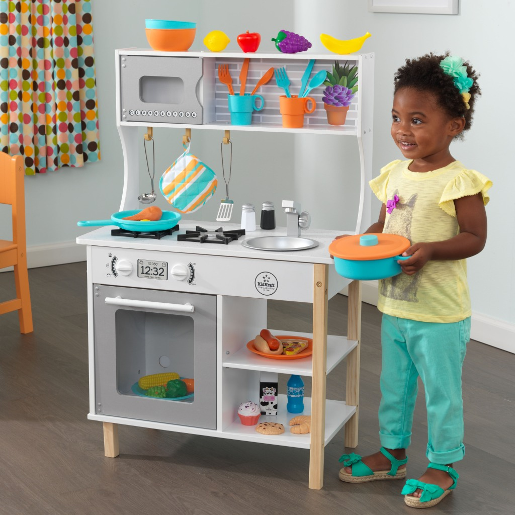 Girl with Kidkraft all Time Play Kitchen