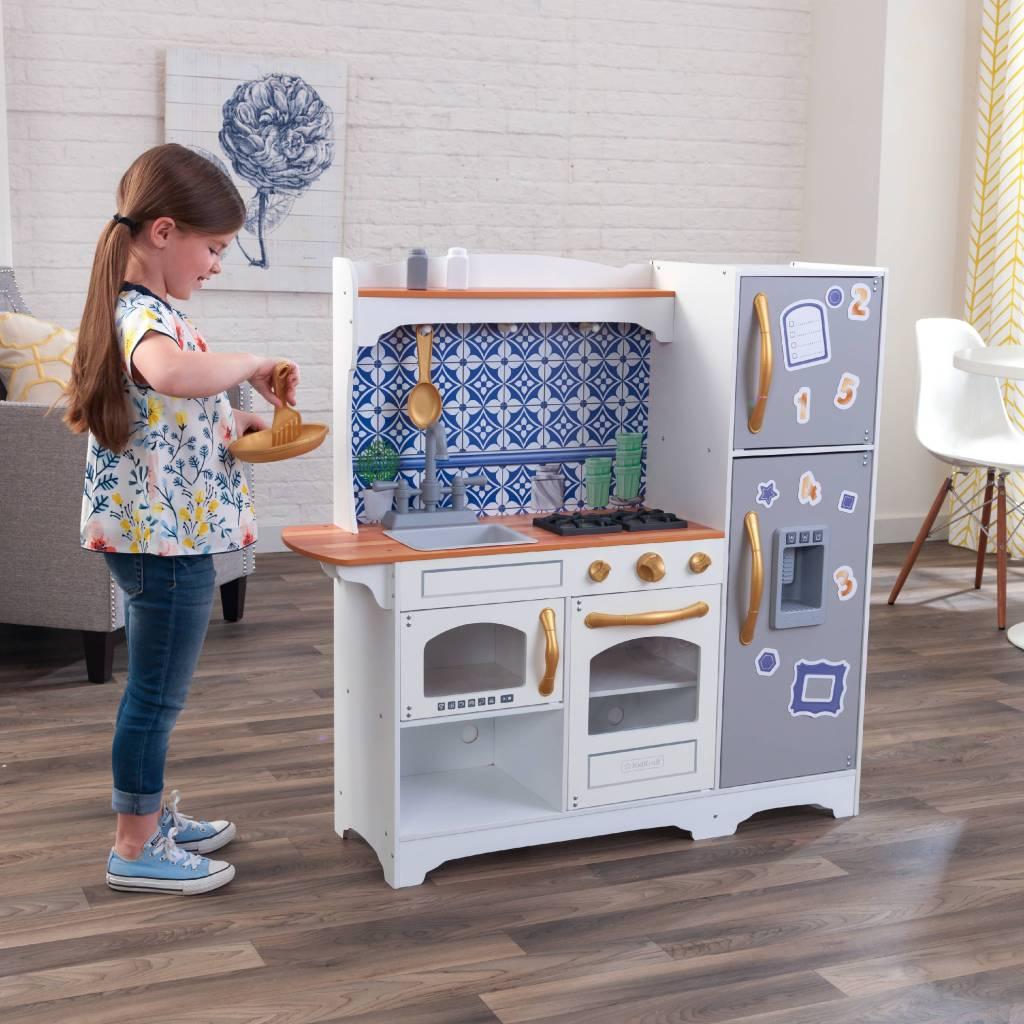 girl playing with Kidkraft mosaic Kitchen