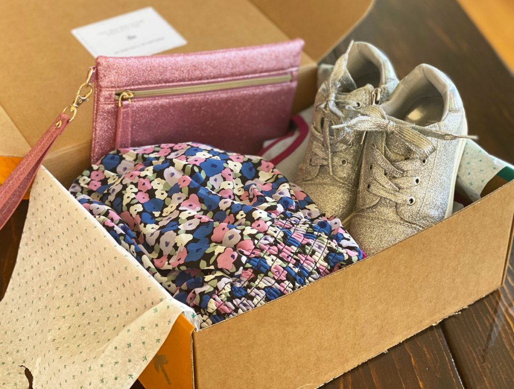 kidpik box with floral dress, gold sneakers, and pink sparkly bag