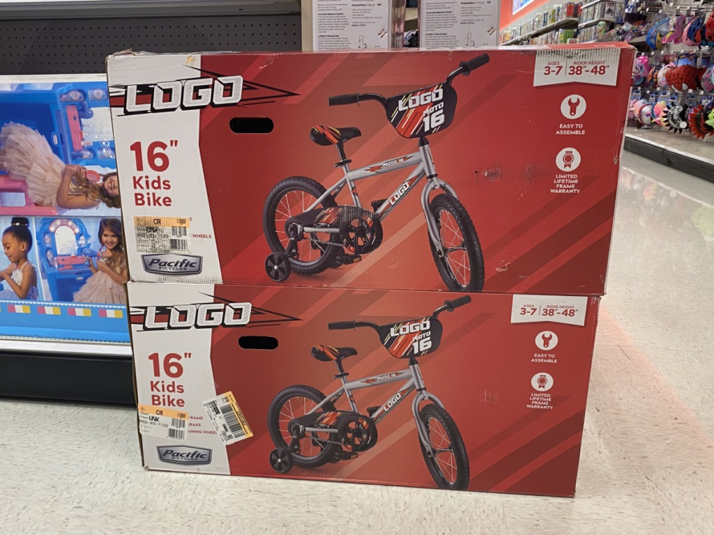 2 kids bikes boxes stacked in store at target