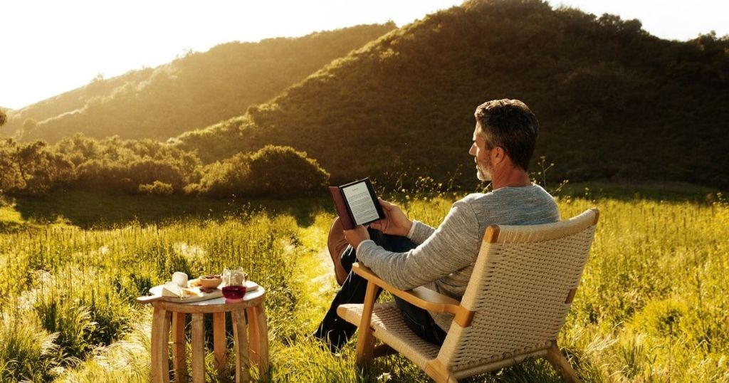 man reading a Kindle Oasis