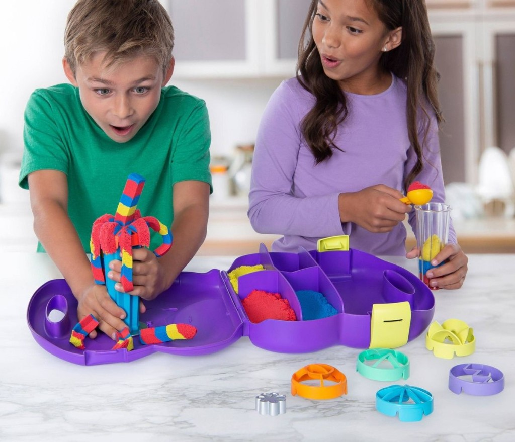two kids playing with kinetic sand