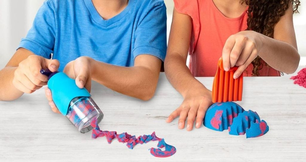 kids playing with a kinetic sand set