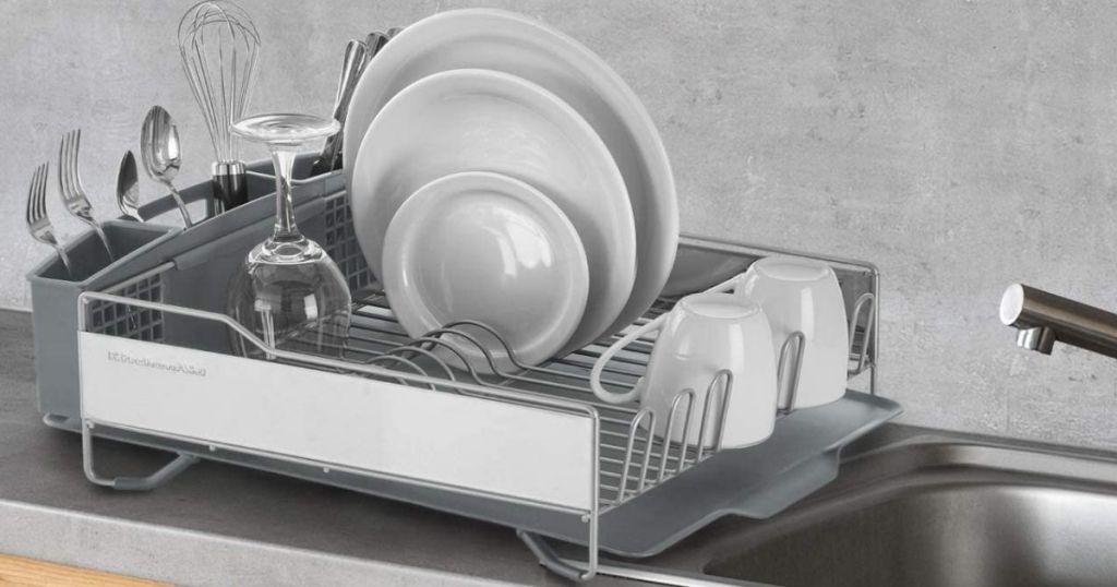 KitchenAid light grey dish rack on counter by sink