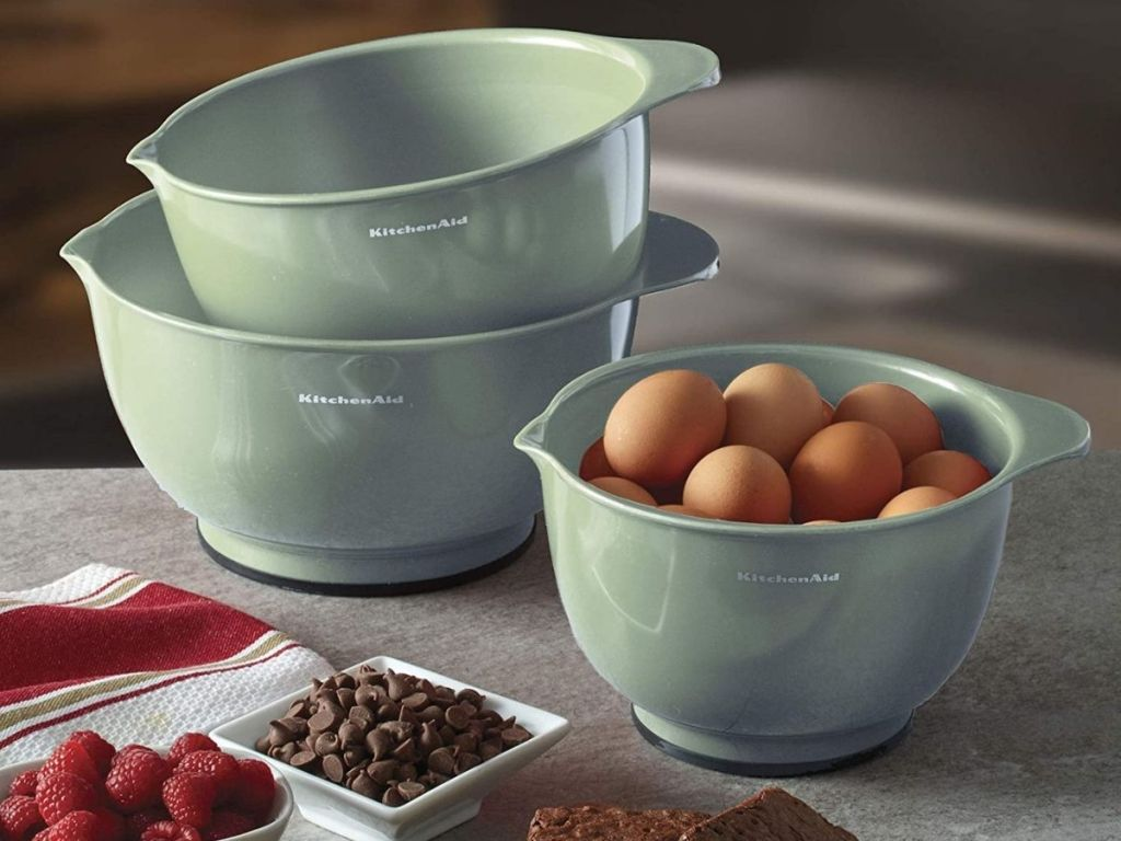 pistachio KitchenAid mixing bowls with one bowl full of eggs