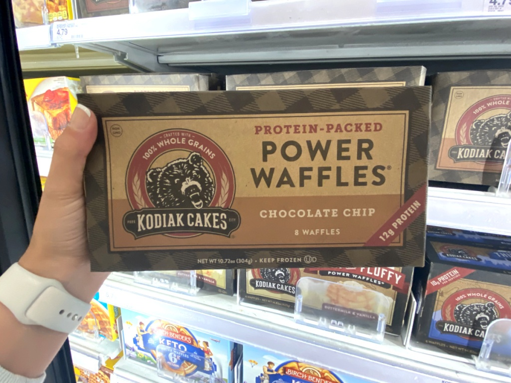 woman's hand holding a box of kodiak cakes in store at target