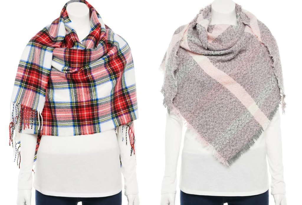 two mannequins in white shirts with plaid blanket scarves on them