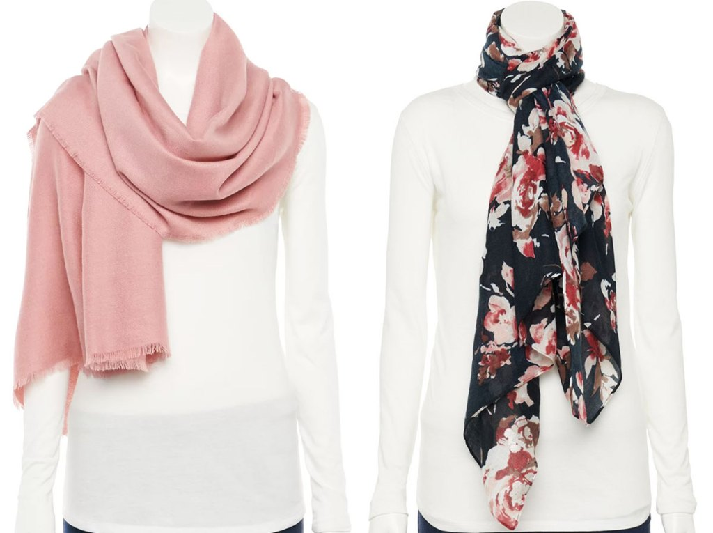 two mannequins in white shirts with light pink and a black floral print scarves