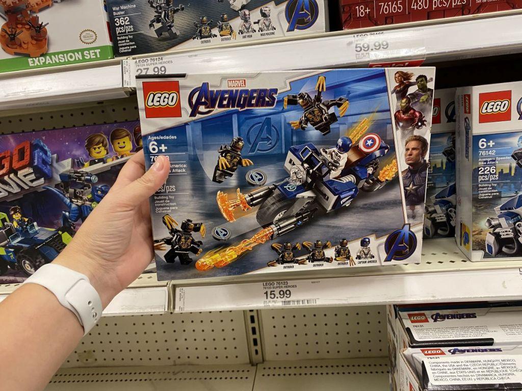 hand holding a LEGO Avengers set
