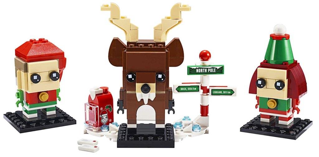 lego brickheads sosok anak laki-laki dan perempuan peri dan rusa dengan kotak surat santa dan tanda kutub utara