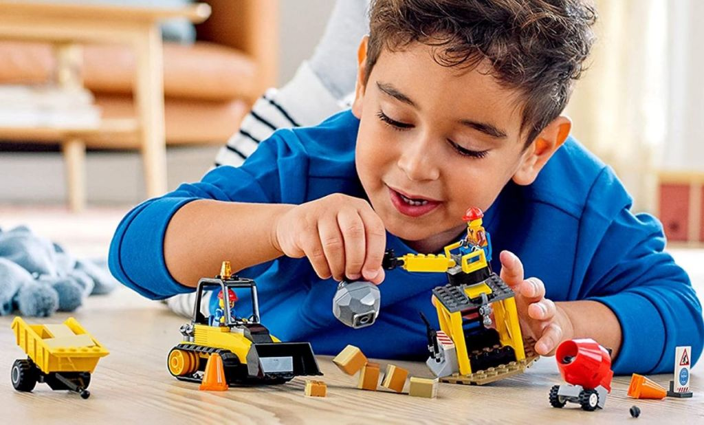 boy playing with a LEGO construction set