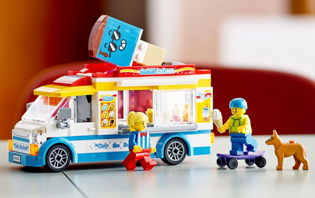 lego ice cream truck set with two minifigures and brown dog
