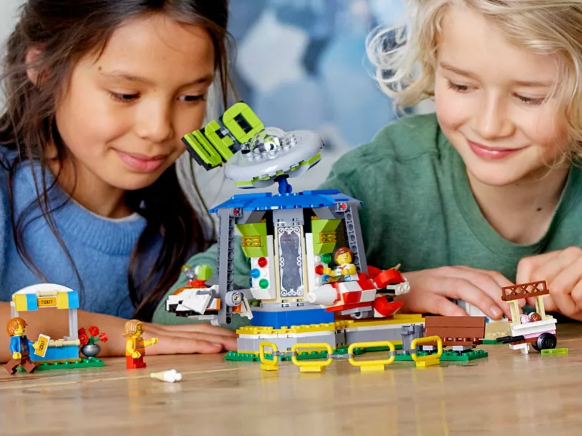 Kids playing with a carnival themed LEGO set