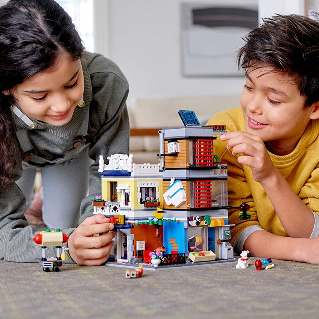 kids playing with a LEGO pet shop set