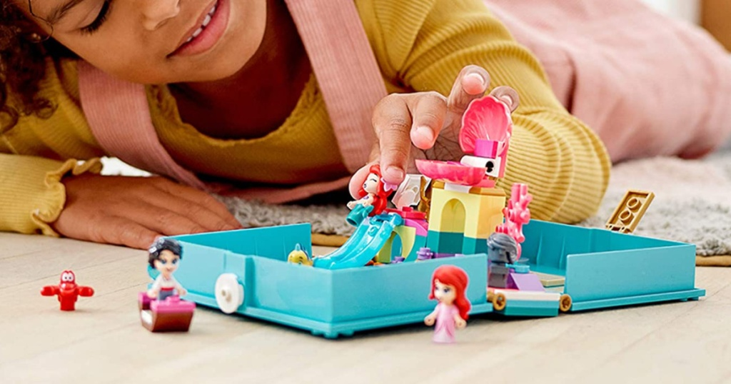girl playing with LEGO Disney Ariel's Storybook Adventures Building Kit