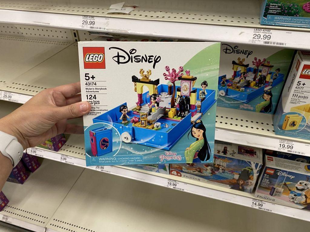 hand holding a LEGO Disney Mulan set