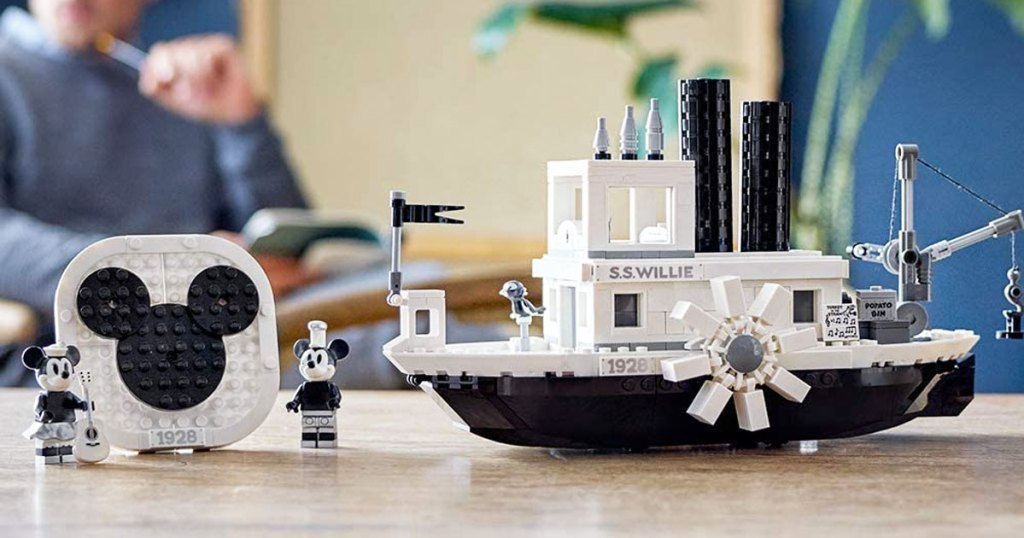 black and white lego steamboat willie boat and miniie and mickey minifgures on a table