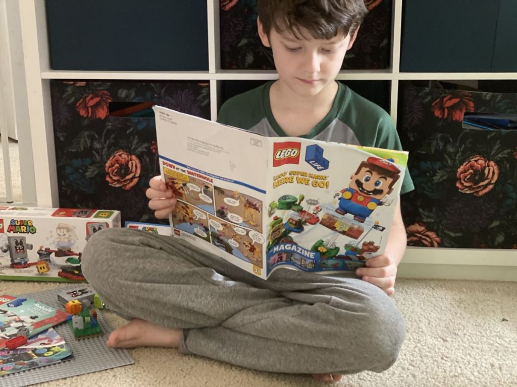 boy reading a LEGO magazine
