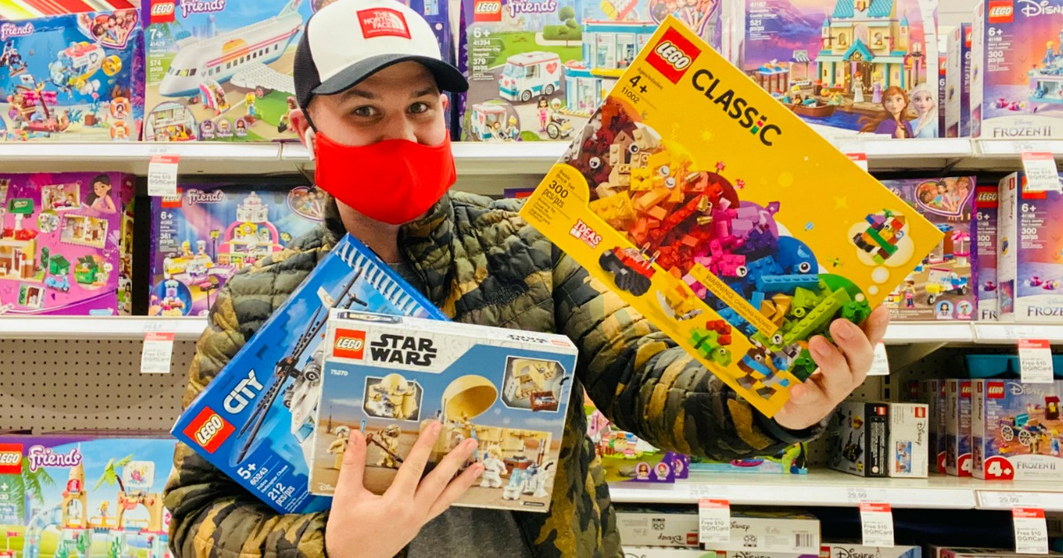 Man wearing bright red mask and shopping for LEGOs in Target