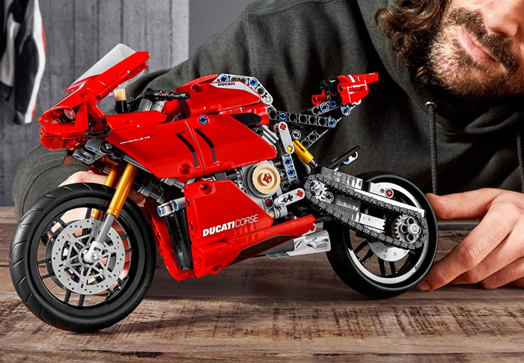 man building a red ducati lego motorcycle