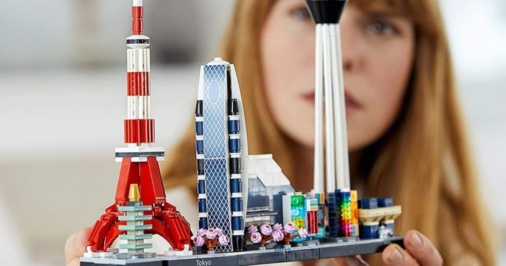 person holding a LEGO set