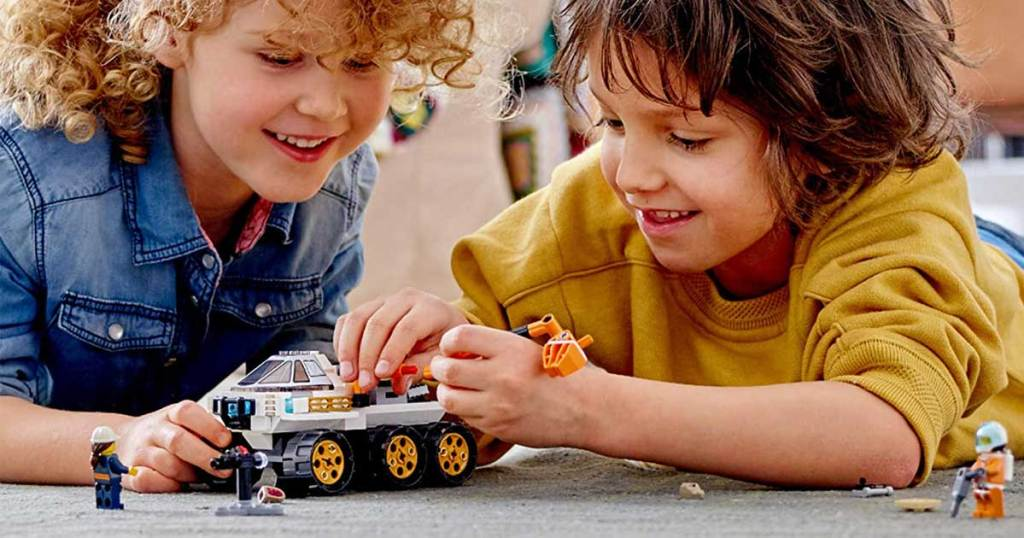 two kids playing with building kit