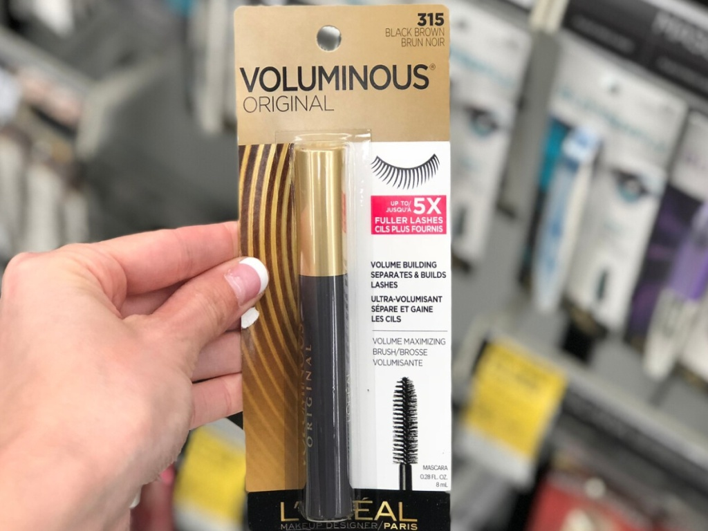 hand holding l'oreal mascara at walgreens