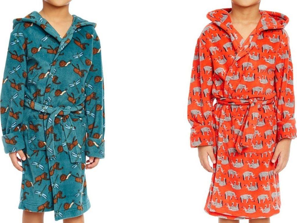 Two kids wearing fleece robes