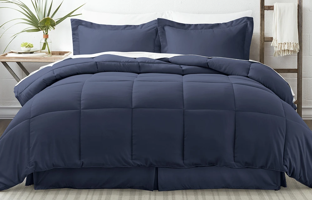 bed with navy bedding on it