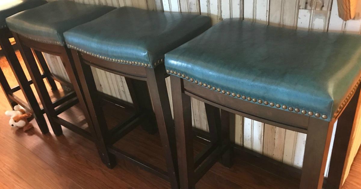 three stools sitting on wood floor
