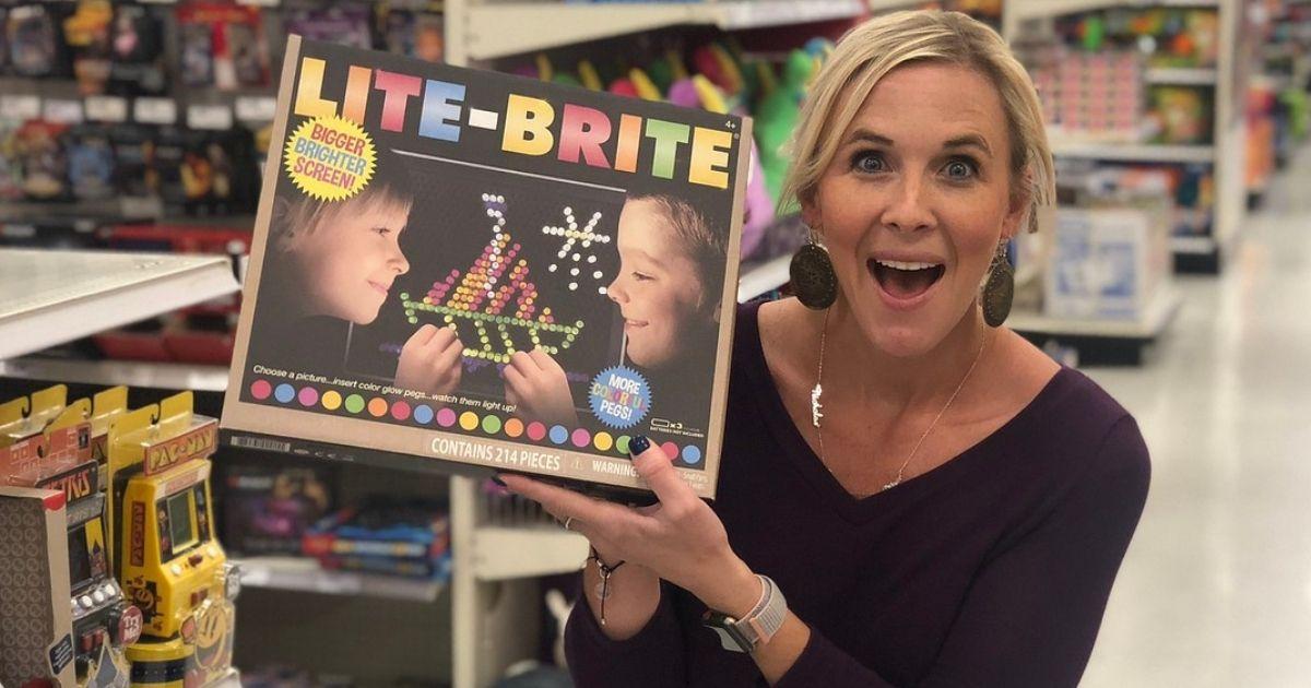 Woman holding a Lite Brite Retro Toy