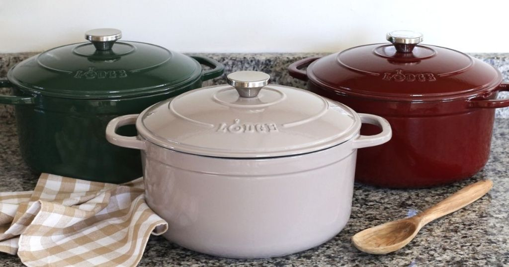 three dutch ovens on a counter
