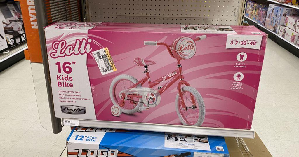 pink bike on shelf