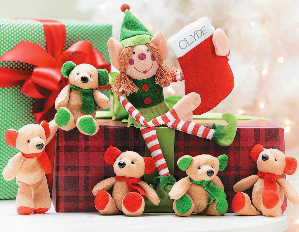 elf and mini christmas bears sitting on top of christmas presents