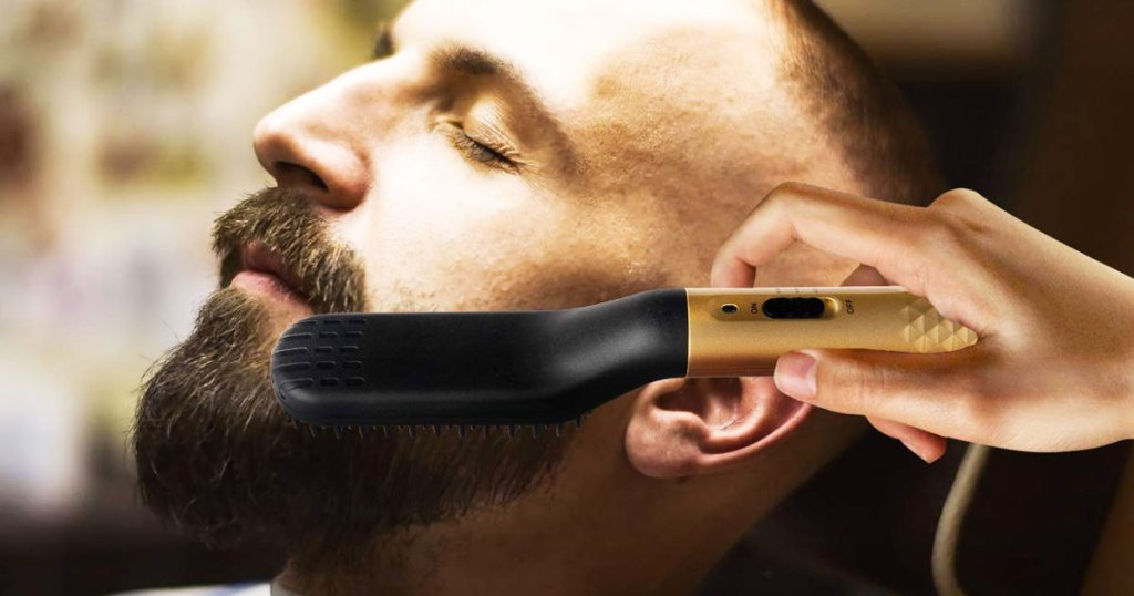 person using a black and gold straightening brush on a man's beard