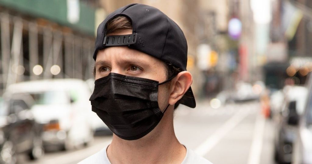 man wearing a disposable face mask