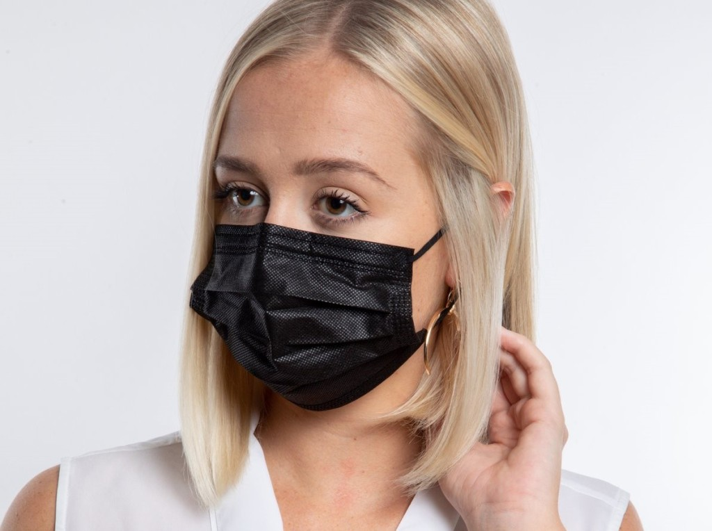 woman wearing a black face mask