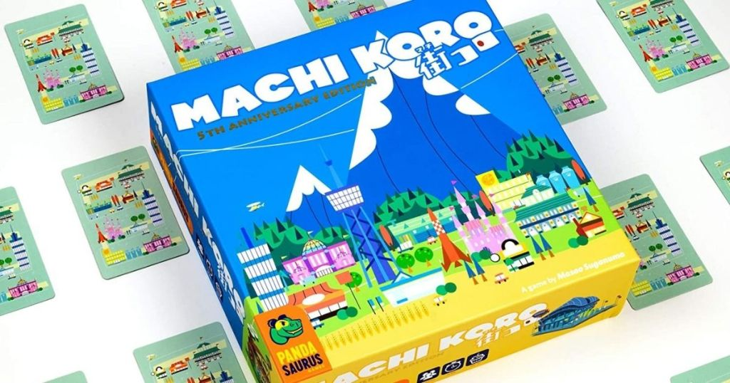 Machi Koro game surrounded by cards