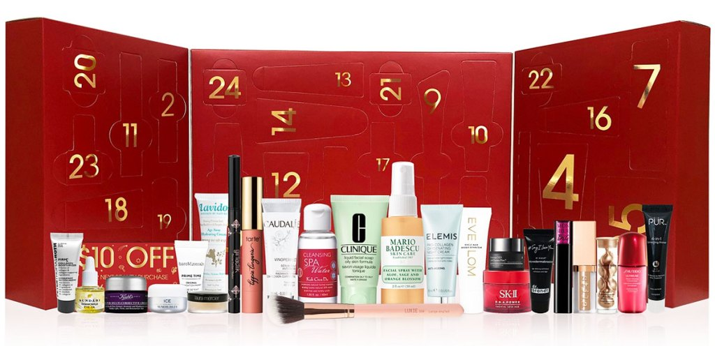red advent calendar box with a bunch of makeup items in front of it