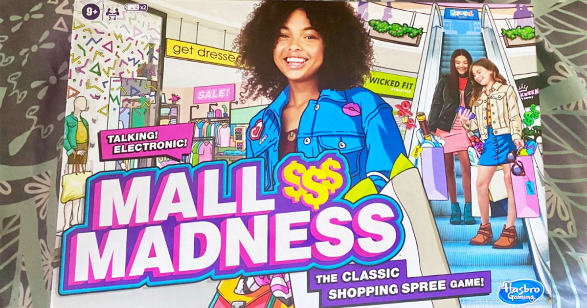 box for the mall madness board game on a bed
