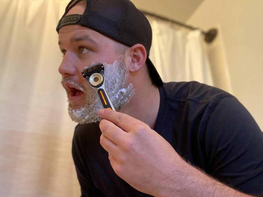 man shaving with gillette heated razor